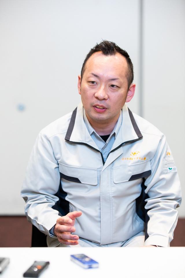 画像: ホール音響設備の選定・導入を担当した「ヨコセAVシステム」の吉澤友樹氏