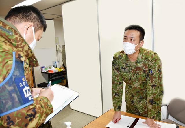 画像: 吉田病院「活動の打ち合わせをする連絡要員」