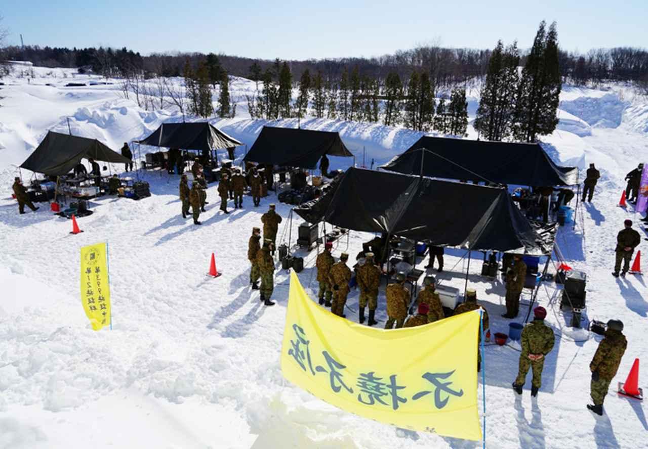 画像: ドカ雪の中での炊事競技会