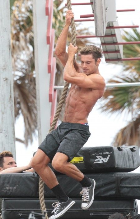 Shirtless Zac Efron on the set of Baywatch in Miami Beach.