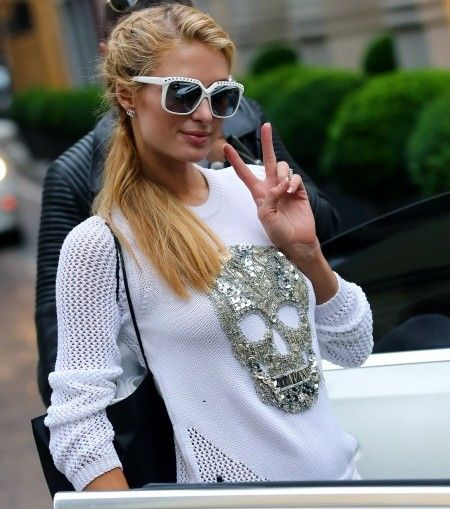 Paris Hilton is seen shopping wearing an all white outfit in Milan Italy.