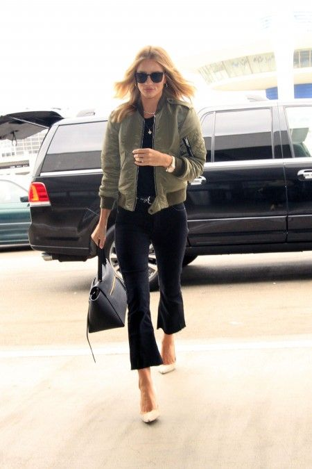 EXCLUSIVE: Rosie Huntington-Whiteley looks runway ready as she catches a flight out of Los Angeles.  The sexy supermodel was seen wearing black pants, tan pumps, a black blouse and an army green jacket.