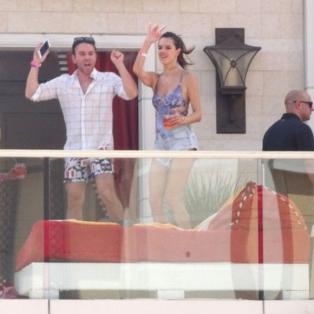 EXCLUSIVE: ** PREMIUM RATES APPLY** Alessandra Ambrosio jumps on a couch to the sounds of Kaskade with her Victoria's Secret models in Vegas at Encore Beach