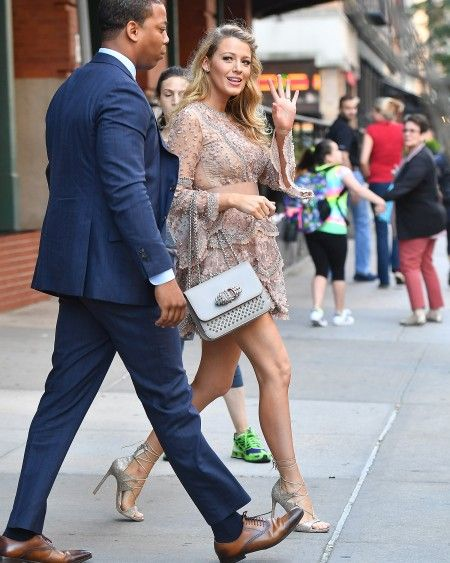 Blake Lively seen wearing a silver nude cocktail dress in New York City