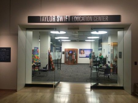 EXCLUSIVE: Taylor Swift beams as she poses with fans at the 'Taylor Swift Education Center' in Nashville, Tennessee.
