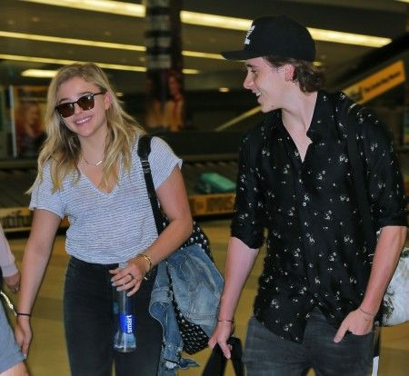 Chloe Moretz and Brooklyn Beckham, and Chloe's mother Teri Duke Moretz arrive at JFK Airport in New York