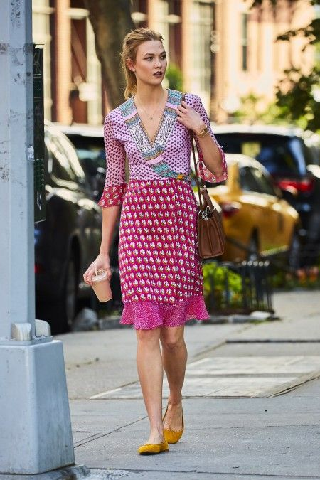 Karlie Kloss spotted wearing a pink summer dress while grabbing coffee in the West Village neighborhood of NYC
