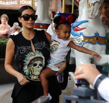 Kim Kardashian spends the day with North West at Disneyland in Anaheim, CA