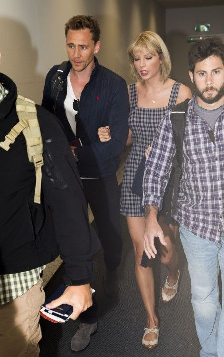 *NO MAIL ONLINE* Taylor Swift and Tom Hiddleston arrive in Australia at Sydney International Airport.