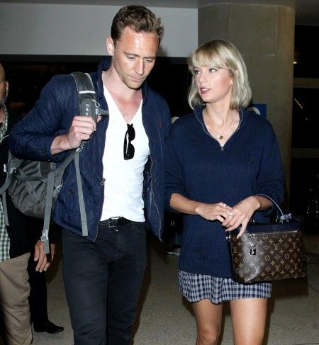 Taylor Swift and Tom Hiddleston arriving at the Los Angeles International Airport