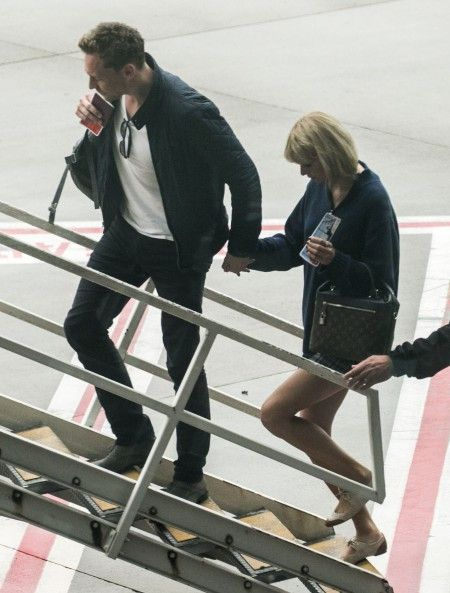 *NO MAIL ONLINE* Taylor Swift and a Tom Hiddleston arrive in Australia and then head to the Gold Coast.
