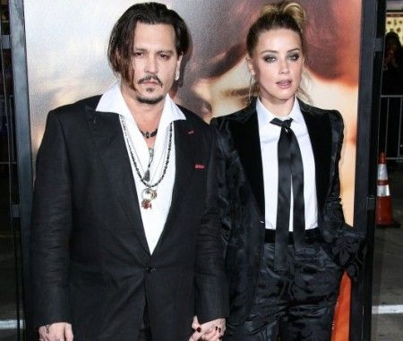 Johnny Depp and wife Amber Heard arrive at the Los Angeles Premiere Of Focus Features' 'The Danish Girl'