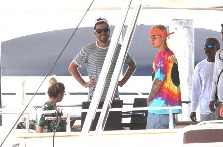 EXCLUSIVE: Justin Bieber boards megayacht with Ashley Benson for a cruise around the bay in Miami