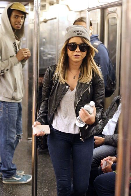 Actress Sarah Hyland takes the 1 Train uptown in SoHo, New York City