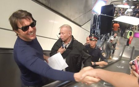 Tom Cruise is surrounded by fans has he walks through a subway in Vienna to film a scene with Simon Pegg for 'Mission: Impossible 5'