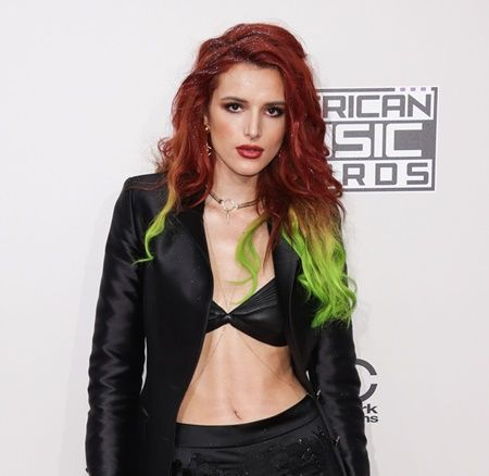 Actress Bella Thorne arrives on the Red carpet at 2016 American Music Awards at Microsoft Theater on November 20, 2016 in Los Angeles, California, United States Pictured: Bella Thorne Ref: SPL1398126  201116   Picture by: Splash News Splash News and Pictures Los Angeles:  310-821-2666 New York:  212-619-2666 London:    870-934-2666 photodesk@splashnews.com